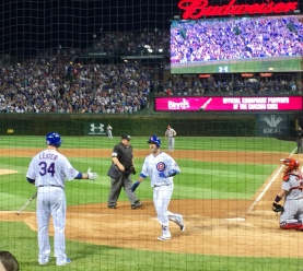 One of the most famous batteries in baseball, Jon Lester congratulates David Ross following Ross's 10th homer of the season.